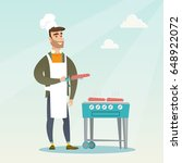 caucasian man cooking steak on... | Shutterstock .eps vector #648922072