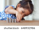 cute asian little girl playing... | Shutterstock . vector #648932986