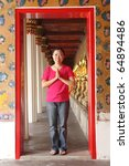 """""""welcome to thailand"""" Woman standing at the door welcoming smile - stock photo"""