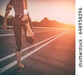 stretching exercise road jogging | Shutterstock . vector #648958396