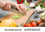 chef cuts the vegetables into a ... | Shutterstock . vector #648958435