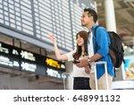 asian couple traveler holding... | Shutterstock . vector #648991132