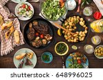 dinner table with grilled steak ... | Shutterstock . vector #648996025