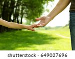 the parent holds the hand of a...   Shutterstock . vector #649027696