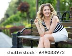 young woman resting in the park | Shutterstock . vector #649033972