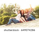 young women having fun outdoors ... | Shutterstock . vector #649074286