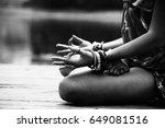 Woman In A Meditative Yoga...