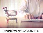 man's hands typing on computer... | Shutterstock . vector #649087816