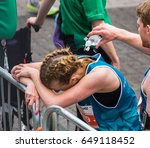 a man helps to cool off a young ... | Shutterstock . vector #649118452