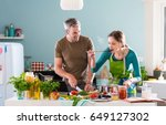 a cheerful couple cooking... | Shutterstock . vector #649127302