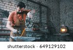 the blacksmith pulls out fire... | Shutterstock . vector #649129102