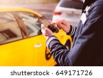 Small photo of Man pointing on screen smartphone background taxi cars, tourist hipster waiting and using in hands mobile phone, traveler connect wifi internet and calls taxi, mockup