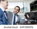 successful businessmen trading... | Shutterstock . vector #649180096