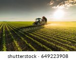tractor spraying pesticides on... | Shutterstock . vector #649223908