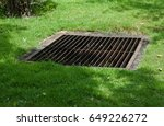 grate off the drain on the lawn. | Shutterstock . vector #649226272