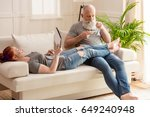 mature woman lying on sofa with ... | Shutterstock . vector #649240948
