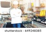positive seller in his grocery... | Shutterstock . vector #649248385