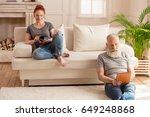 husband using digital tablet... | Shutterstock . vector #649248868