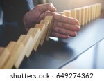 concept of solution and domino... | Shutterstock . vector #649274362
