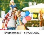 happy family walking along the... | Shutterstock . vector #649280002