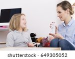 child counselor discussing... | Shutterstock . vector #649305052