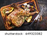Small photo of Barbecue Lamb Shoulder with Vegetables and Feta as top view on cutting board