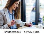 beautiful woman drinking coffee ... | Shutterstock . vector #649327186