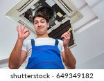 worker repairing ceiling air... | Shutterstock . vector #649349182