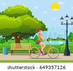 woman riding a bicycle in... | Shutterstock .eps vector #649357126