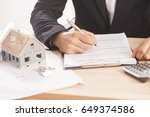 businessman signing a mortgage  ... | Shutterstock . vector #649374586