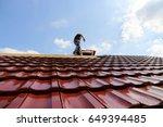 roofer at work  | Shutterstock . vector #649394485