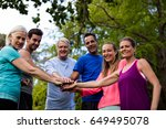 group of people doing a hand... | Shutterstock . vector #649495078