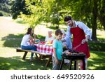 father and son barbequing in... | Shutterstock . vector #649520926