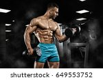 handsome man with big muscles ... | Shutterstock . vector #649553752