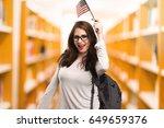 student woman holding an... | Shutterstock . vector #649659376