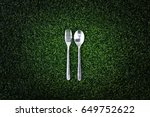 fork and knife on grass texture ... | Shutterstock . vector #649752622