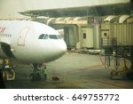 Small photo of BANGKOK, THAILAND - FEB, 24: The airliner ground service release airbridge attach in position before airliner departure represent the airport service business on February 24, 2017 in Bangkok Thailand.