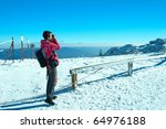 young girl in winter mountains - stock photo