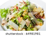 appetizer - salad with cheese on white plate - stock photo