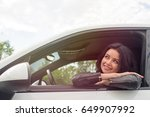 young woman sitting inside car... | Shutterstock . vector #649907992