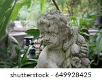 Cherub Statue In The Garden