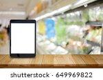 empty screen tablet on wood... | Shutterstock . vector #649969822