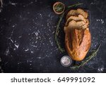 bread and rosemary on a wooden... | Shutterstock . vector #649991092