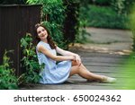 girl pose to camera at park...   Shutterstock . vector #650024362