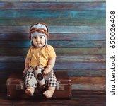 boy in a knitted pilots cap... | Shutterstock . vector #650026408