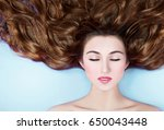 beautiful woman with long... | Shutterstock . vector #650043448