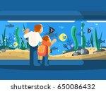 dad with son in oceanarium   Shutterstock .eps vector #650086432