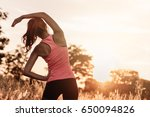 young female stretching before... | Shutterstock . vector #650094826