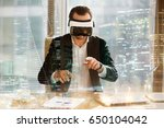 businessman in virtual reality... | Shutterstock . vector #650104042
