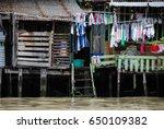 life in the slums of bangkok... | Shutterstock . vector #650109382